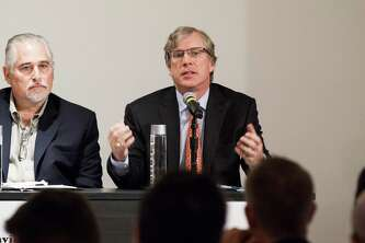 Tom Pickens, center, addresses the Houston Technology Center s annual Innovation Conference and Showcase about the status of angel investing in Greater Houston on Oct. 7, 2014. Pickens started and operated 18 companies and is currently CEO Astrotech Corp., which made its name preparing payloads for satellites and the space shuttle. On the left is David Steakley, chairman of the Houston Angel Network.