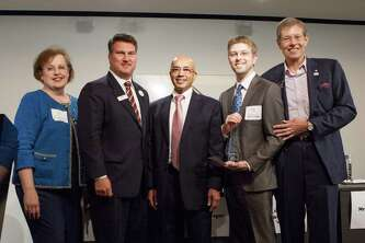 Sean Honore , second from the right, received the Goradia Innovation Grand Prize from  Vijay Goradia, center, at the Houston Technology Center s annual Innovation Conference and Showcase on Oct. 7, 2014. Honore  is CEO of Sohmiume LLC, a Houston start-up that has developed a nanotube technology to help survivors of heart attacks. Also in the photo are Walter Ulrich, president and CEO of the Houston Technology Center, on the right; Deborah Mansfield, director of live sciences at the Gulf Coast Regional Center of Innovation and Commercialization, on the left, and second from the left is Bob Pertierra, chief economic development officer for the Greater Houston Partnership.