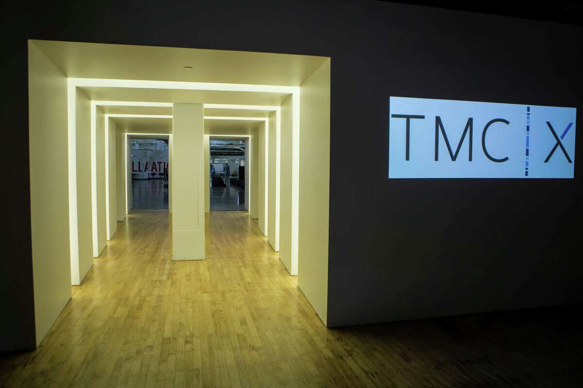 The TMCx portal separates the reception and conference space from the main workspace and includes access to a large training room. Thursday, Oct. 9, 2014, in Houston.