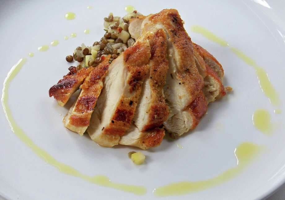 A perfectly seared chicken breast makes a tasty weeknight meal. Photo: Photos By Edmund Tijerina / San Antonio Express-News