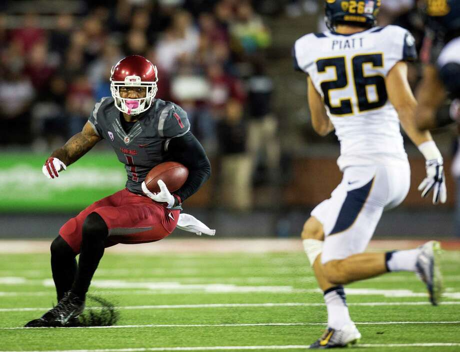 Washington State receiver Vince Mayle, looking for yardage against Cal's Griffin Piatt, ranks No. 3 nationally with 51 catches and is one of four Cougars with six or more touchdown catches. Photo: Dean Hare / Associated Press / FR158448 AP