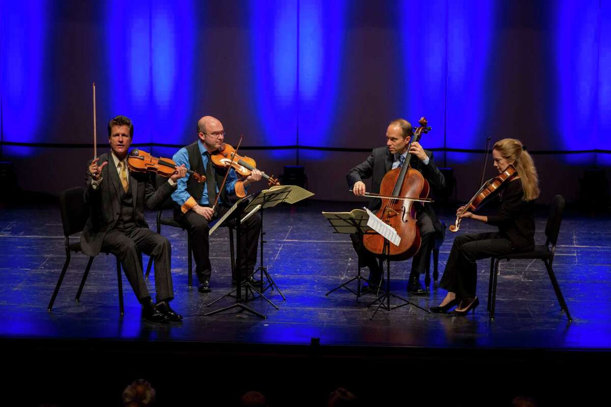 """Geoff Nuttall, first violinist of the St. Lawrence String Quartet, discusses Joseph Haydn's """"Emperor"""" Quartet with Da Camera's audience in a September concert. The quartet's slow movement borrows the melody of a patriotic song by Haydn, """"God Protect the Emperor Franz,"""" and the quartet's opening notes symbolize the German version of that title, """"Gott Erhalte Franz den Kaiser."""""""
