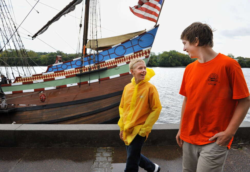 Ethan Radley, 12, left, of Rensselaer and Benjamin Krijnsen, 14, of Heerenveen, The Netherlands recount their voyage along with other Dutch and American middle school students aboard the replica 17th century sailing ship Half Moon at Albany's Corning Preserve Tuesday Sept. 18, 2012, after they re-created the original voyage of Henry Hudson from September 1609. (John Carl D'Annibale / Times Union)