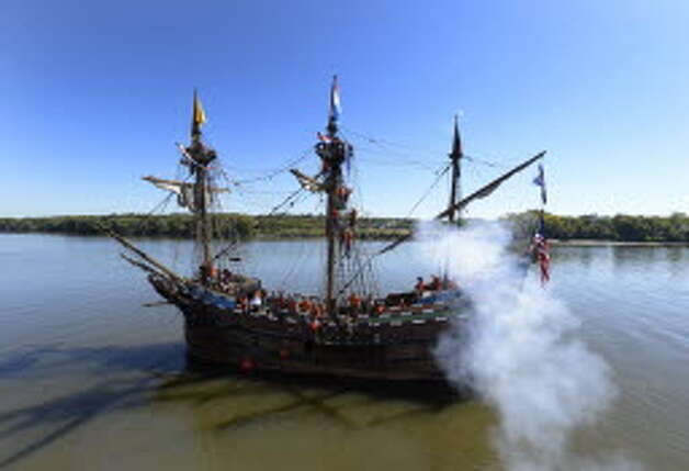 The replica of Henry Hudson's ship the Half Moon fires off a cannon as it arrives a its mooring at the Corning Preserve this morning Sept 19, 2013 in Albany, N.Y. (Skip Dickstein/Times Union)