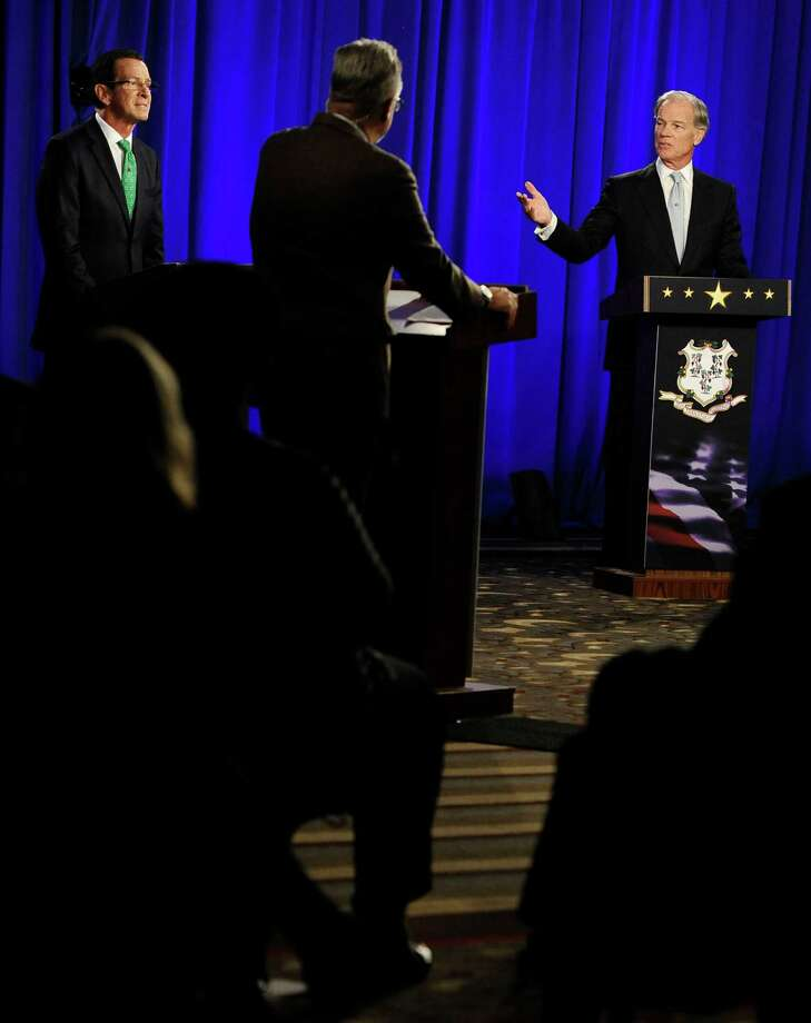 Republican candidate for governor Tom Foley, right, gestures as incumbent Democrat Gov. Dannel P. Malloy, left, listens, during a debate, Thursday, Oct. 9, 2014, in Hartford, Conn. Photo: Jessica Hill, AP Photo/Jessica Hill / Associated Press