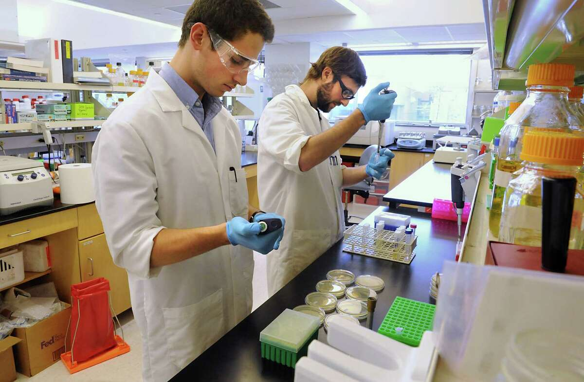 Rensselaer Polytechnic Institute students Patrick Wasil and Nick Marchand remove foreign DNA into bacteria in a lab at the Center for Biotechnology on Thursday, Oct. 9, 2014 in Troy, N.Y. RPI celebrates 100 years of chemical engineering. (Lori Van Buren / Times Union)