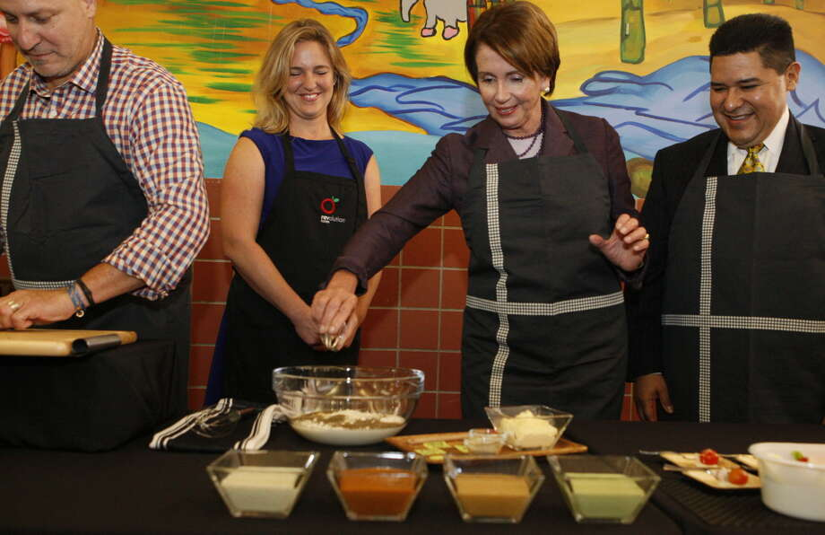 Congresswoman Nancy Pelosi and Chef Tom Colicchio      at Mission High School on Thursday, October 9, 2014. Photo: Terray Sylvester / The Chronicle / ONLINE_YES