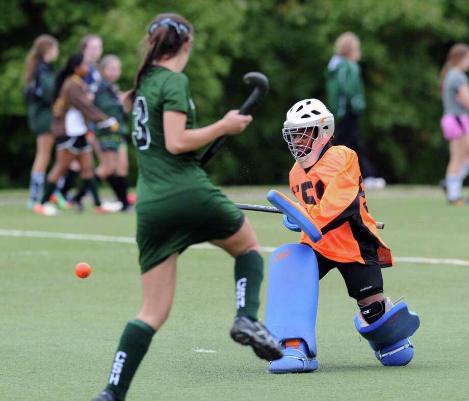 Convent goalie Stephanie Comer, right, makes a stop as Convent teammate, Madeleine DeVita (#3) looks on during the high school field hockey match between Convent of the Sacred Heart and Holy Child at Convent in Greenwich, Conn., Thursday, Oct. 9, 2014. Photo: Bob Luckey / Greenwich Time
