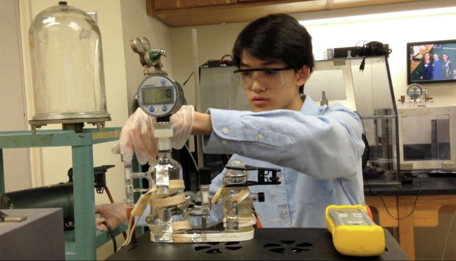 Greenwich High School senior Andrew Ma is one of Popular Mechanics' nine Future Breakthrough Award winners. Here, he works in the high school's lab on a prototype of his ammonia-nitrogen removal and reuse apparatus. Photo: Contributed Photo / Greenwich Time