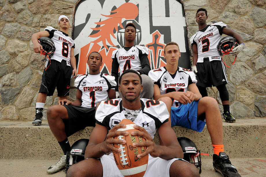 Black Knight quarterback Jalen Brown, center foreground, is surrounded by some of his offensive team playmakers from left: Jon Michael Bivona, Zaire Mabry, Andrew Antoine, Billy DeVito and Tyree Smith. Photographed at Stamford High School in Stamford, Conn., on Thursday, Oct. 9, 2014. Photo: Jason Rearick / Stamford Advocate