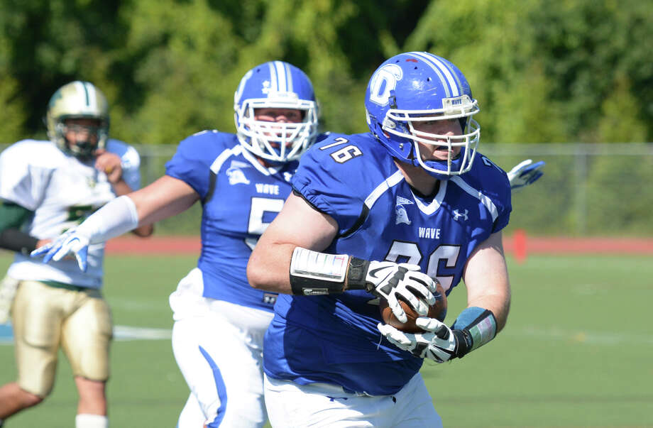 Darien's Jack Griffiths (76) carries the ball for a touchdown during the first quarter of the football game against Bassick High School at Darien on Saturday, Sept. 27, 2014. Photo: Amy Mortensen / Connecticut Post Freelance
