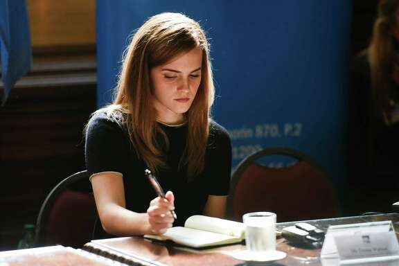 Emma Watson, UN Women Goodwill Ambassador, takes notes during an event at Parliament in Montevideo, Uruguay, Wednesday, Sept. 17, 2014. Watson attended the event organized by women's groups which are pushing the country's lawmaking body to increase its numbers of elected female senators and deputies. (AP Photo/Matilde Campodonico)