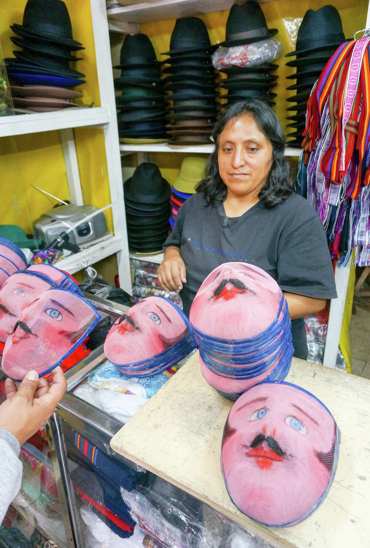 Spanish rucu masks for sale in the hat shop of César Anchala in the San Roque neighborhood. Quito is still colorful, and safer, after a renovation.