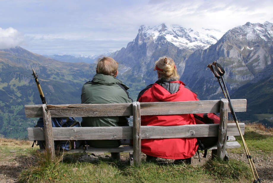 A well-situated bench rewards these hikers with a spectacular alpine panorama. Photo: Dominic Bonuccelli / Rick Steves' Europe / ONLINE_YES