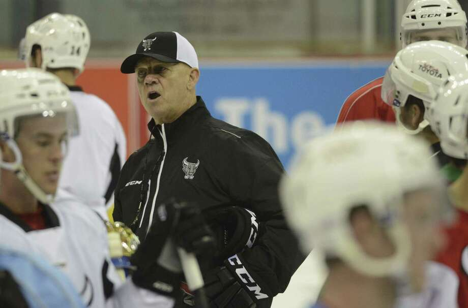 After accepting the head coaching job 11 games into last season, Tom Rowe is happy to have been with the Rampage since Day 1 of training camp for this season, which starts tonight. Photo: Billy Calzada / San Antonio Express-News