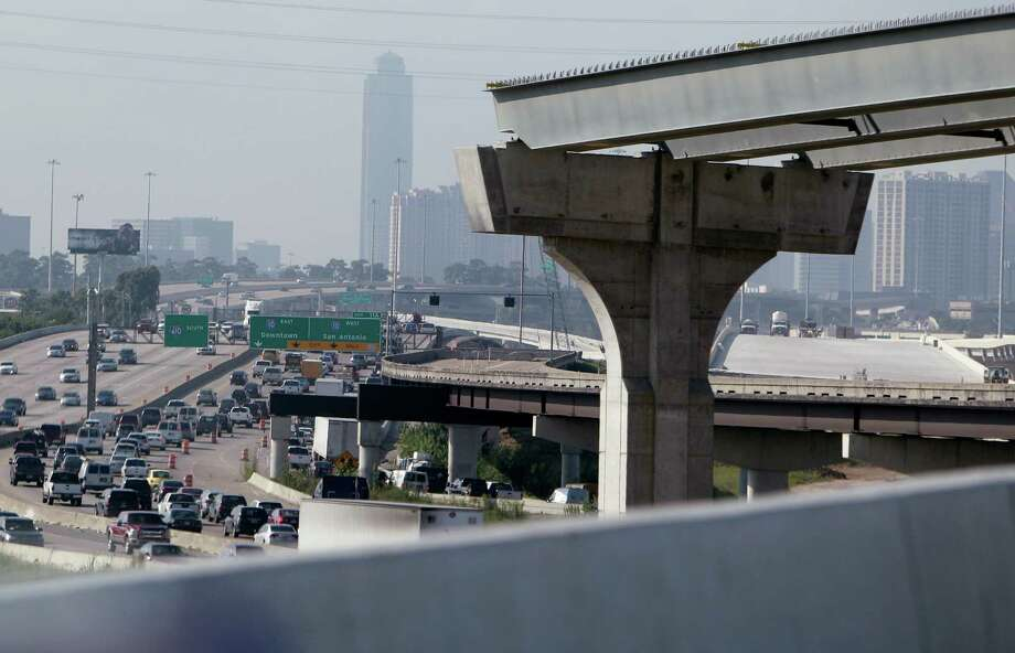 The new Loop 610 overpass connecting to Interstate 10 overlooks columns for related ongoing projects. Photo: Mayra Beltran, Staff / © 2014 Houston Chronicle