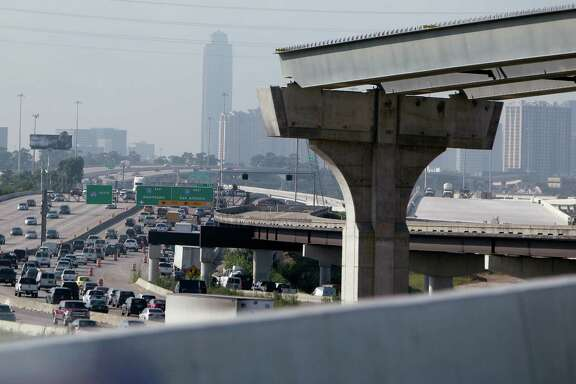 The new Loop 610 overpass connecting to Interstate 10 overlooks columns for related ongoing projects.