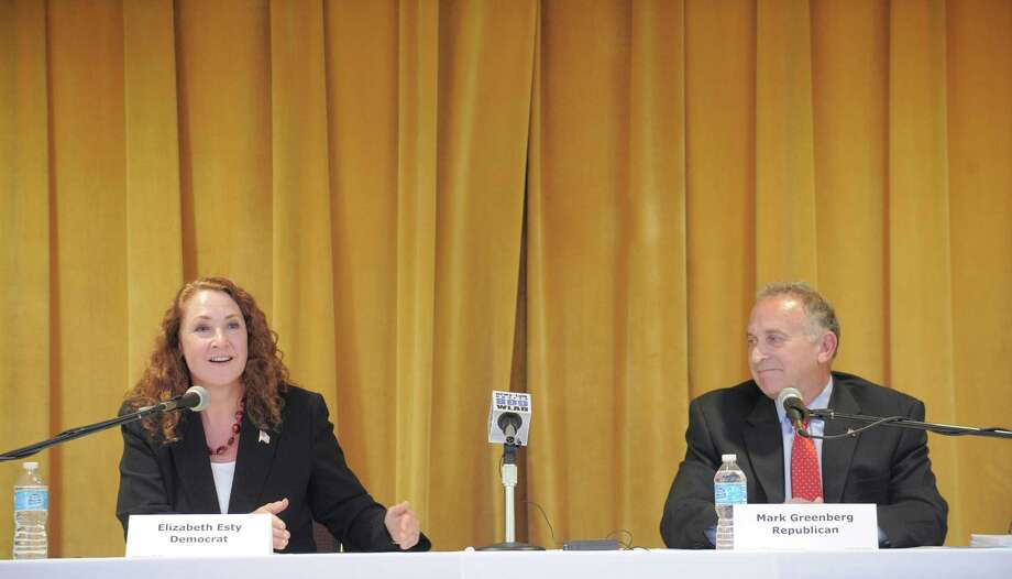 The 5th Congressional District debate between incumbent Democrat Elizabeth Esty, left, and Republican challenger Mark Greenberg, right, held at the Portuguese Cultural Center, in Danbury, Conn, on Thursday night, October 9, 2014. The debate was sponsored by Hearst Connecticut Media, the League of Women Voters and the Portuguese Cultural Center. Photo: H John Voorhees III / The News-Times Staff Photographer