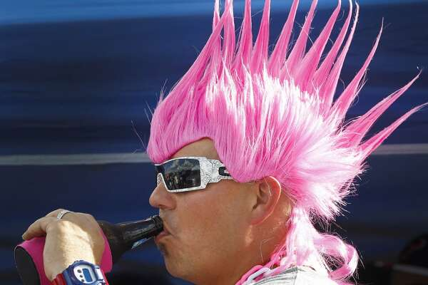 J.T. Kirk sports his pink wig while tailgating before the game.