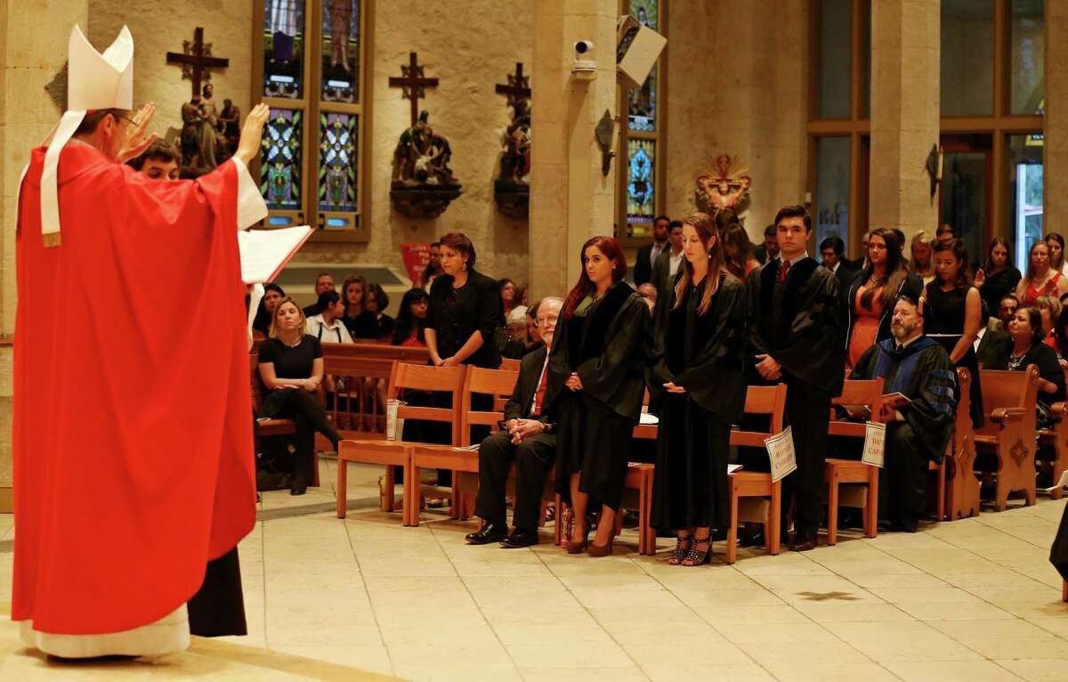 San Antonio Archbishop Gustavo Garcia-Siller (left) blesses members of the legal profession during the 62nd annual Red Mass held Thursday Oct. 9, 2014 at San Fernando Cathedral.