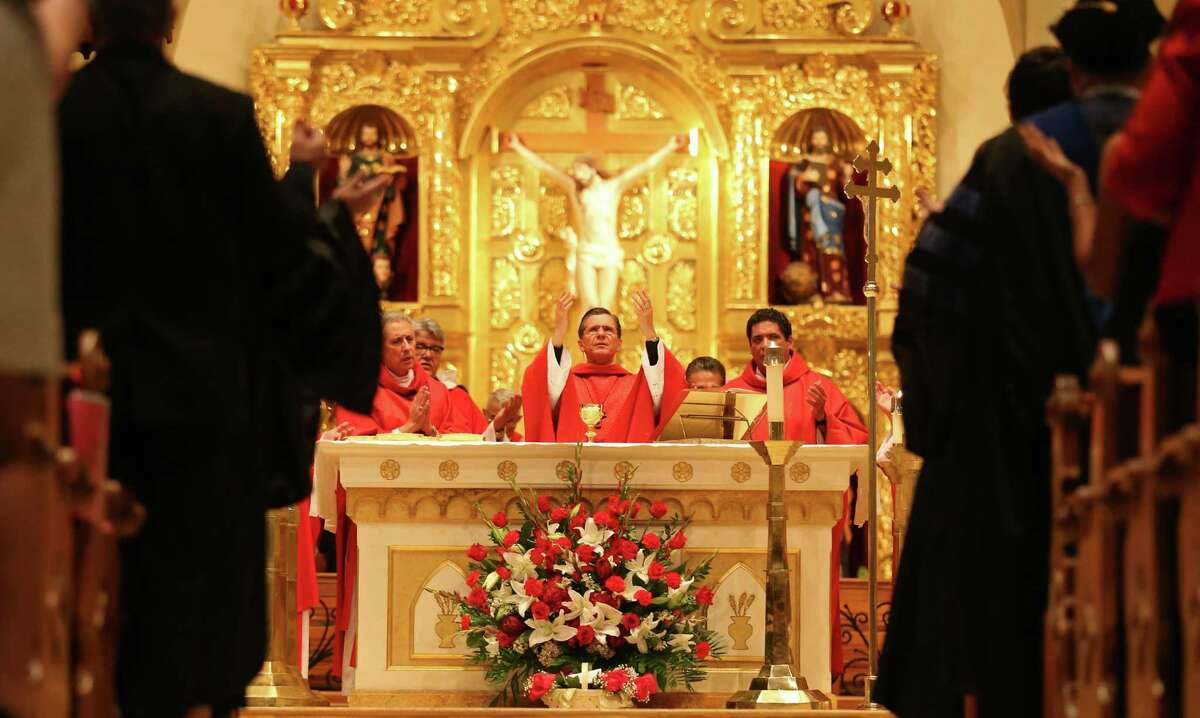 San Antonio Archbishop Gustavo Garcia-Siller (center) leads the 62nd annual Red Mass held Thursday Oct. 9, 2014 at San Fernando Cathedral. The Red Mass is a special ceremony held for members of the legal industry.