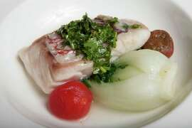 A dish by Kohanaiki Executive Chef Patrick Heymann and presented at a banquet at Cavallo Point Lodge in Sausalito: Steamed snapper with ginger scallion cilantro pesto, baby bok choy and hamakua grape tomatoes splashed with hot peanut oil immediately before serving.