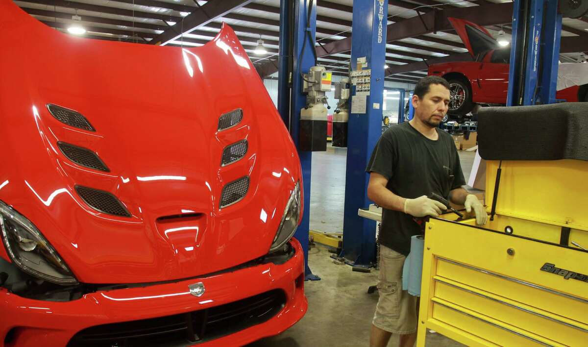 Tony Maltez putting new cylinder heads on a 2013 Viper at Hennessey Performance in Sealy.(For the Chronicle/Gary Fountain)