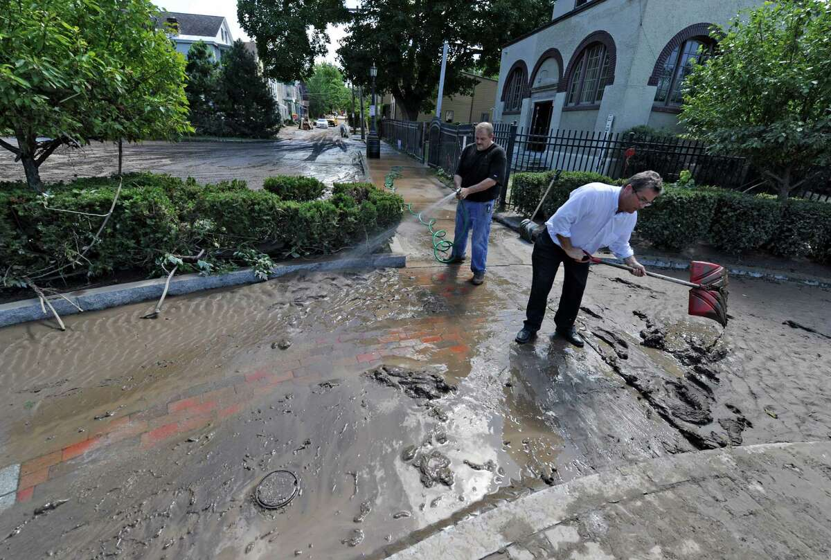 Carl Olsen, Commissioner of OGS City of Schenectady, right, and Andrew Coppola of Violia Water clean the walkway near the pumping station in the Stockade section Aug 30, 2011, in Schenectady, N.Y. Olsen resigned after 23 years with the city to take a job as director of operations at the Empire State Plaza. (Skip Dickstein/ Times Union archive)