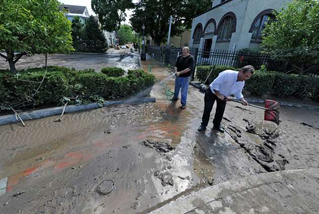 Carl Olsen, Commissioner of OGS City of Schenectady, right, and Andrew Coppola of Violia Water clean the walkway near the pumping station in the Stockade section Aug 30, 2011, in Schenectady, N.Y. Olsen resigned after 23 years with the city to take a job as director of operations at the Empire State Plaza. (Skip Dickstein/ Times Union archive) Photo: Skip Dickstein / 00014452A