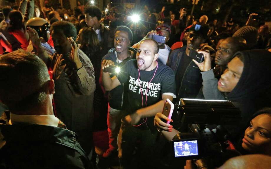 Crowds confront police near the scene in south St. Louis where Vonderrit Myers, a black 18-year-old, was fatally shot by a white officer. Photo: David Carson / St. Louis Post-Dispatch / St. Louis Post-Dispatch