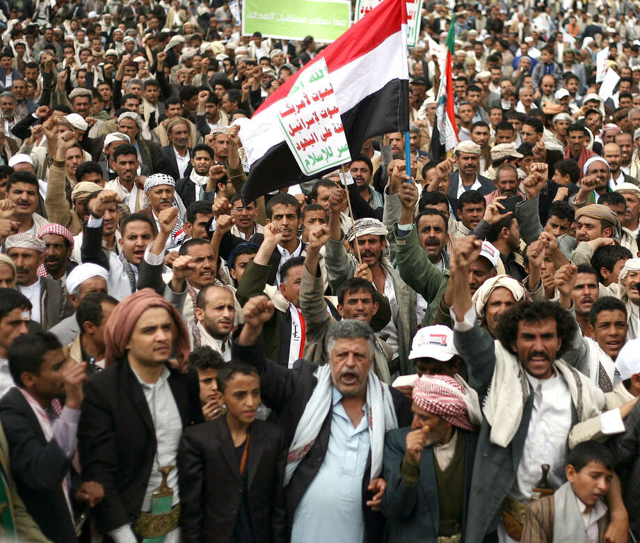 Houthi Shiite rebels chant slogans during a protest near the site of a suicide bombing in Sanaa, Yemen. Photo: Abdullrhman Huwais / Associated Press / AP