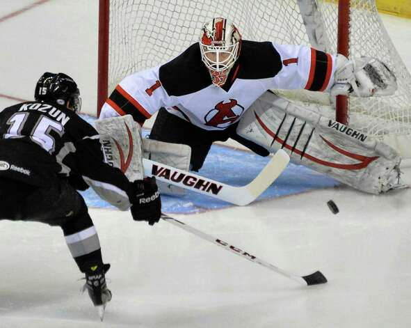 Albany Devil's goalie Keith Kinkaid, at right, stops a shot from Monarchs #15 Brandon Kozun during Saturday's game at the Times Union Center Jan. 11, 2014, in Albany, NY.  (John Carl D'Annibale / Times Union) Photo: John Carl D'Annibale / 00025290A