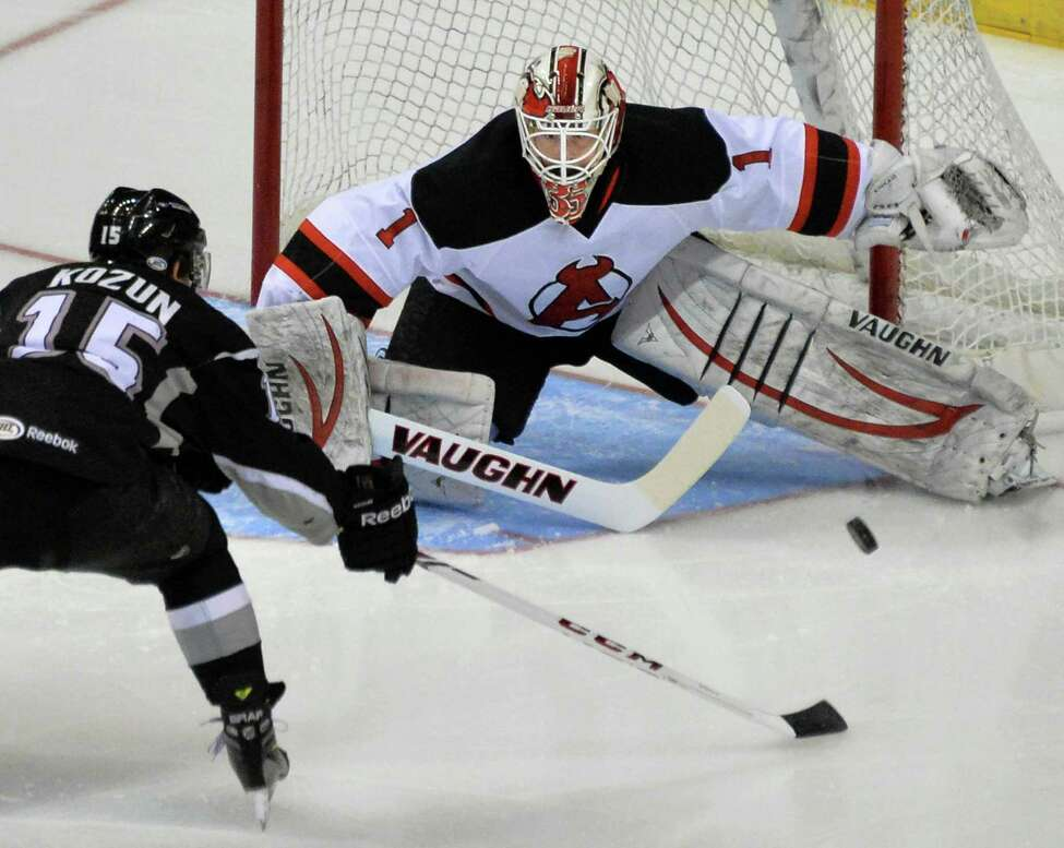 Albany Devil's goalie Keith Kinkaid, at right, stops a shot from Monarchs #15 Brandon Kozun during Saturday's game at the Times Union Center Jan. 11, 2014, in Albany, NY. (John Carl D'Annibale / Times Union)
