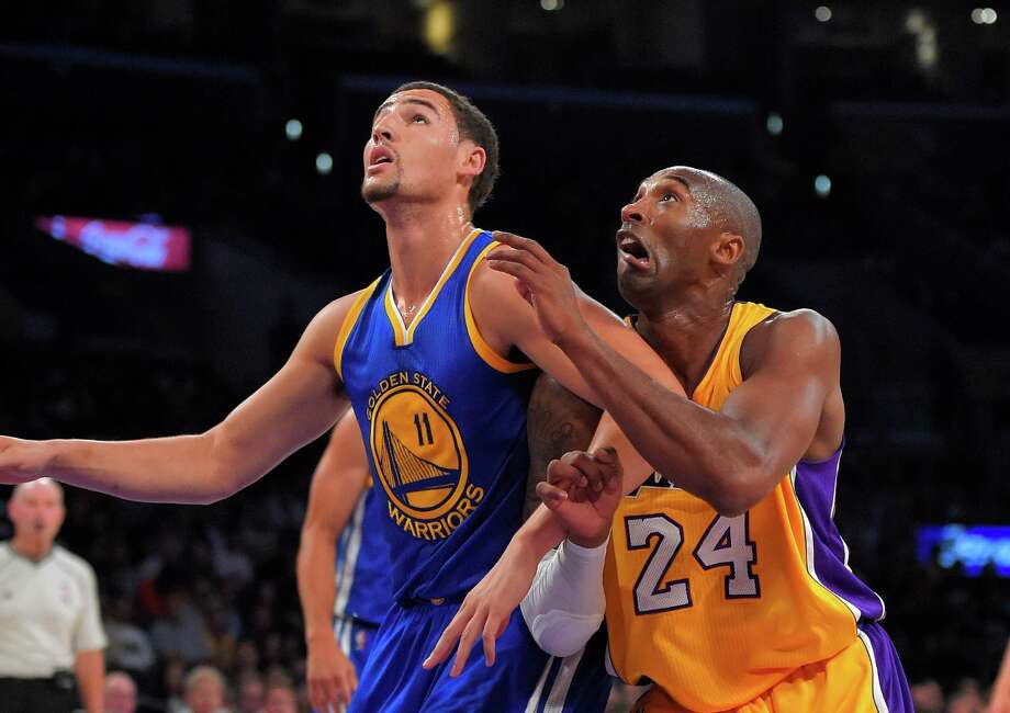 Klay Thompson (left), who had 25 points, and Kobe Bryant battle for a rebound during the first half. Photo: Mark J. Terrill / Associated Press / AP