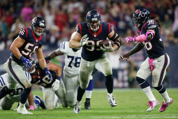 Defensive end J.J. Watt heads to the end zone for his third touchdown of the season after picking up a fourth-quarter fumble Thursday night at NRG Stadium.