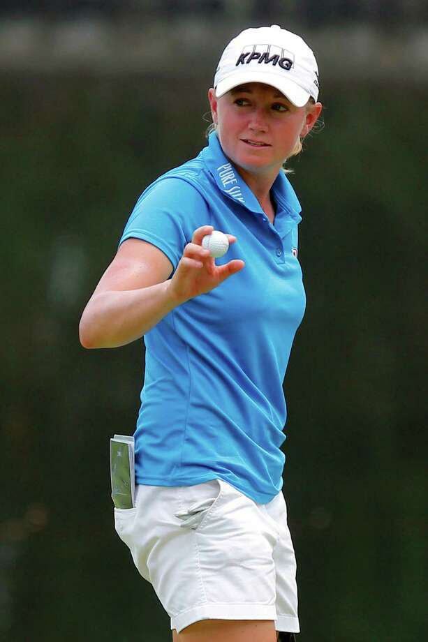 Stacy Lewis of the United States reacts after making a birdie putt on the 16th green during the first round of the LPGA Malaysia golf tournament at Kuala Lumpur Golf and Country Club in Kuala Lumpur, Malaysia, Thursday, Oct. 9, 2014. (AP Photo/Lai Seng Sin) Photo: Lai Seng Sin / Associated Press / AP