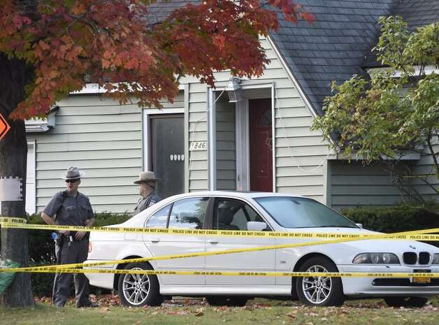 State Police experts returned to 1846 Western Ave.,  Guilderland, Friday, to continue the hunt for clues inside the Cape Cod-style home where two adults and two children were found dead on Wednesday. (Skip Dickstein / Times Union)