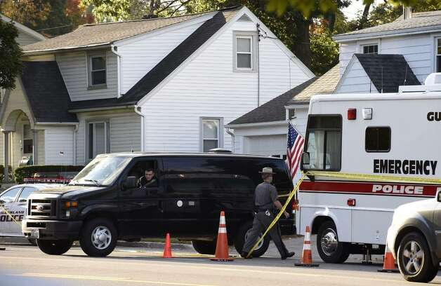 A State Police forensics van returned to 1846 Western Ave.,  Guilderland, Friday, to continue the hunt for clues inside the Cape Cod-style home where two adults and two children were found dead on Wednesday. (Skip Dickstein / Times Union)