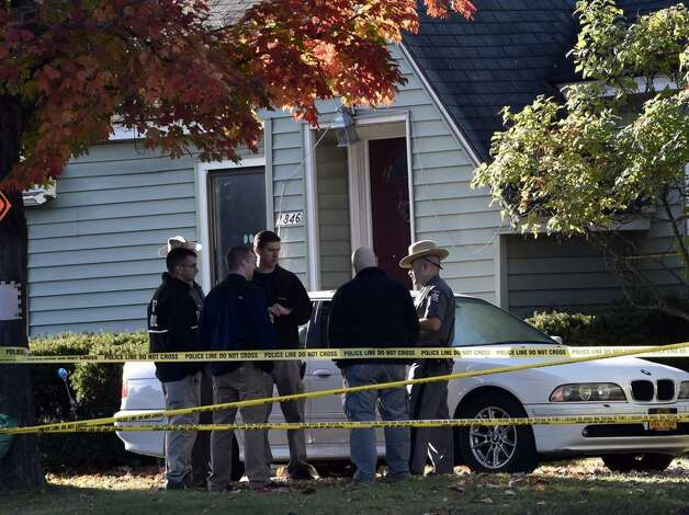 A State Police experts returned to 1846 Western Ave.,  Guilderland, Friday, to continue the hunt for clues inside the Cape Cod-style home where two adults and two children were found dead on Wednesday. (Skip Dickstein / Times Union)