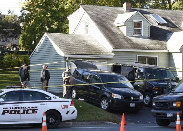 A State Police returned Friday morning to 1846 Western Ave., Guilderland, the home where two adults and two children were found dead on Wednesday. (Skip Dickstein / Times Union)