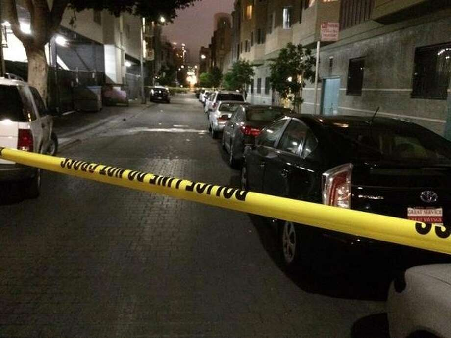 One person was shot and killed, another shot and injured, on Natoma Street between 6th and 7th streets in San Francisco early Friday, Oct. 10, 2014. Photo: Hamed Aleaziz, The Chronicle