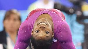Simone Biles of the US performs on the floor during the women's all-around final at the gymnastics world championships in Nanning on October 10, 2014.   AFP PHOTO/KAZUHIRO NOGIKAZUHIRO NOGI/AFP/Getty Images