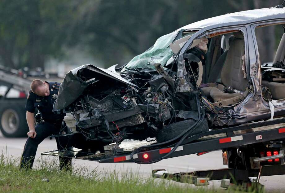 A Harris County sheriffâÄôs deputy was hurt in a wreck about 3 a.m. that left the driver of a Ford Fusion hospitalized and his passenger killed along the 15300 block of Clay Road near North Eldridge Parkway Friday, Oct. 10, 2014, in Houston, Texas. The Ford was traveling the wrong way in the eastbound lanes, authorities said. Photo: Gary Coronado, Houston Chronicle / © 2014 Houston Chronicle