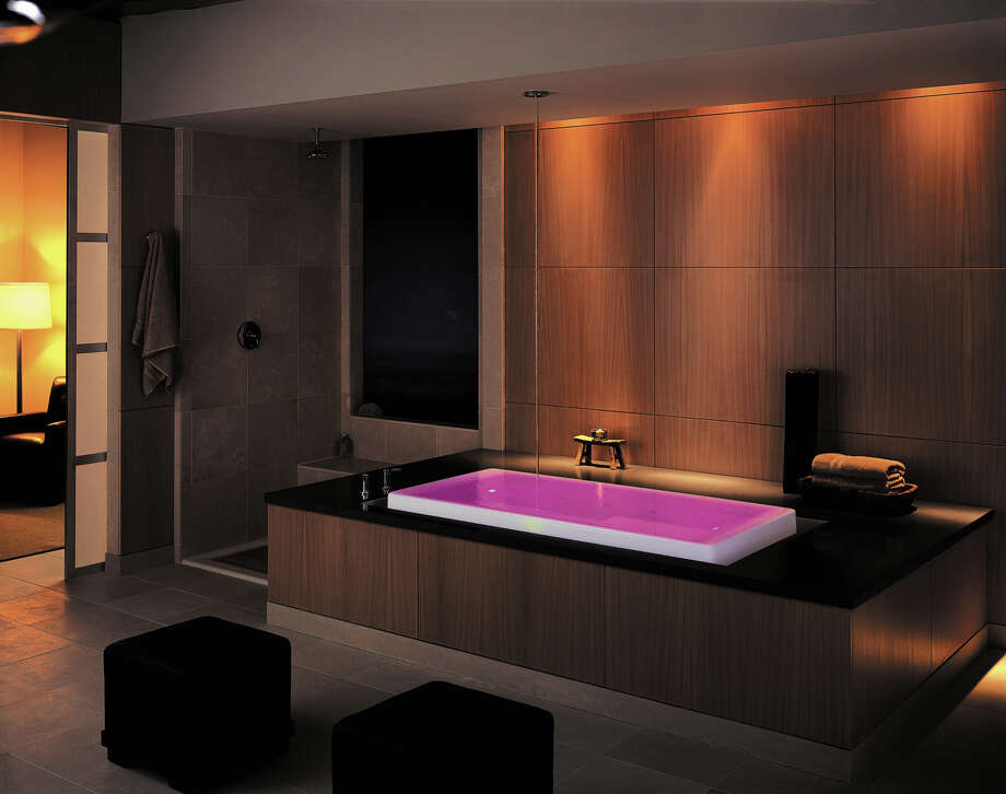 Bathing gets fancy with LED lights that change the color of the water, creating a soothing, spalike experience that homeowners want in the master bath. Photo: Kohler / Courtesy
