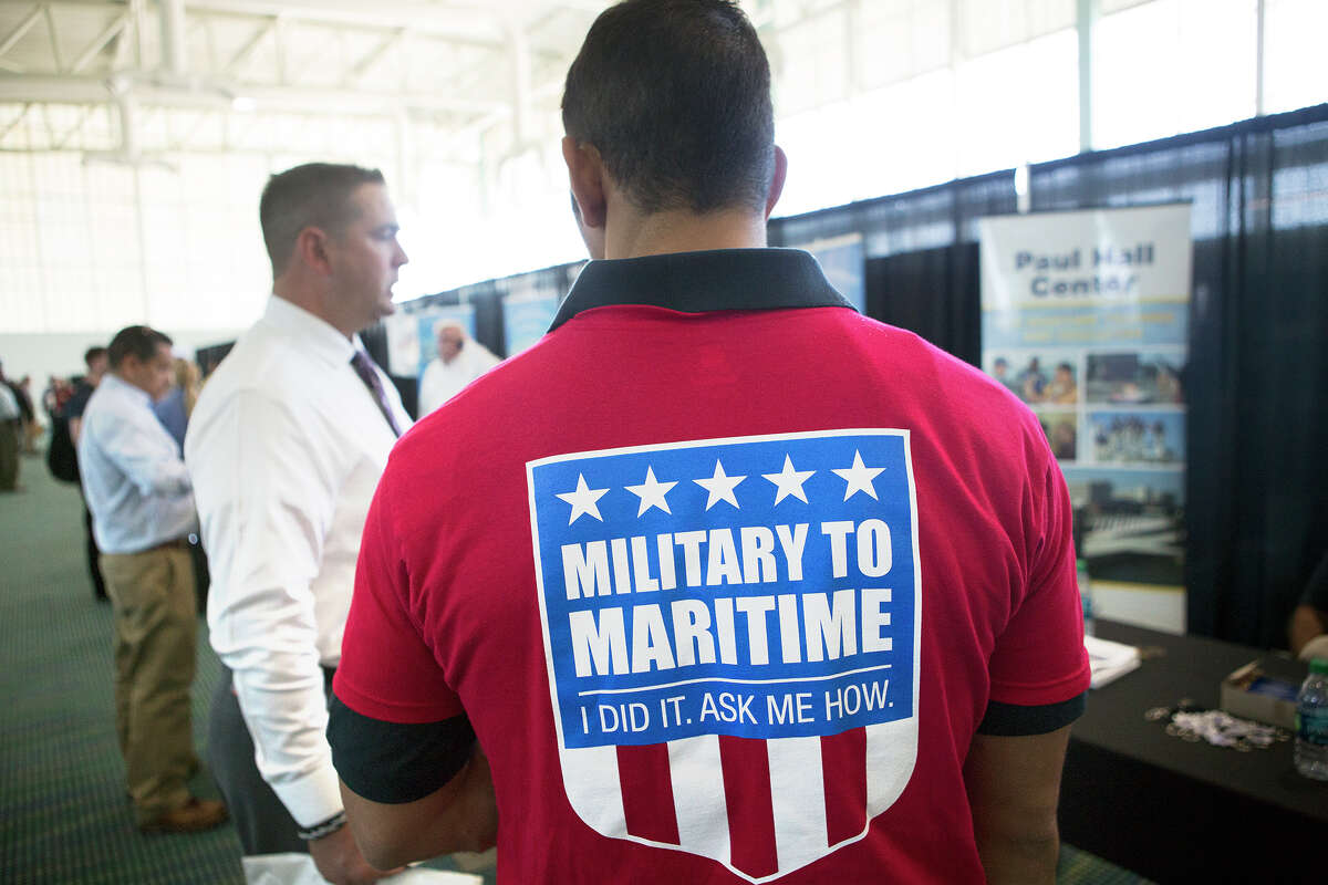 Seafarers International Union of North America patrolman Joe Zavala, right, talks with Chris Lamm, left, during a job fair hosted by The American Maritime Partnership at the Bayport Cruise Terminal, Wednesday, Sept. 3, 2014, in Pasadena. The fair is designed for ex-military to interview for maritime jobs. (Cody Duty / Houston Chronicle)