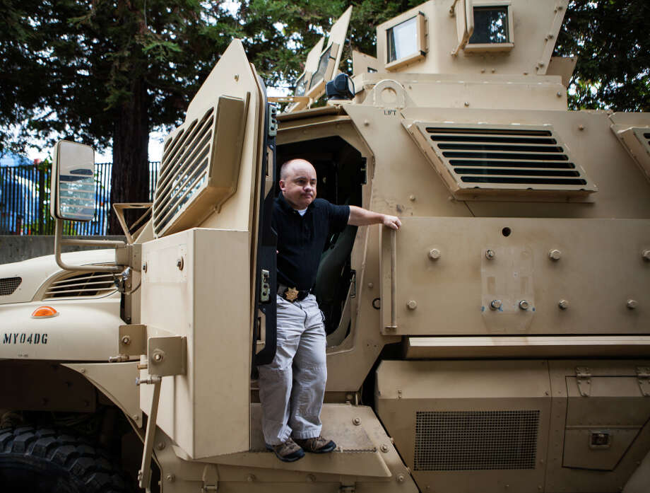 Return to sender: Lt. Thomas Waltz climbs down from an armored vehicle that showed up, unwelcomed, in Davis. Photo: MAX WHITTAKER / New York Times / NYTNS