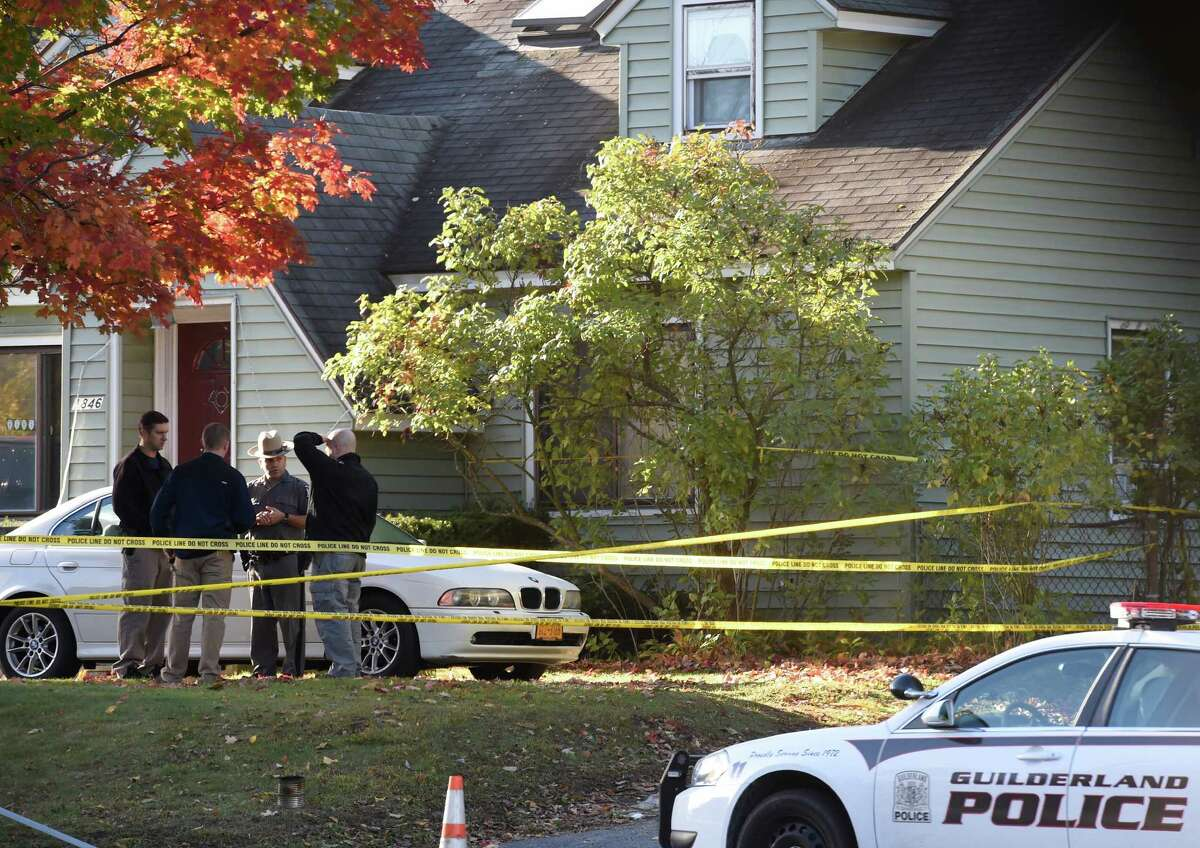 A New York State Police forensics unit returns to the scene of a quadruple homicide at 1846 Western Avenue to continue their investigation Friday morning, Oct. 10, 2014, in Guilderland, N.Y. (Skip Dickstein/Times Union)
