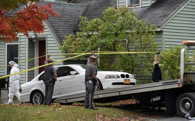 The car that was parked at the scene of a quadruple homicide at 1846 Western Avenue is removed Friday morning, Oct. 10, 2014, as the investigation continues in Guilderland, N.Y. (Skip Dickstein/Times Union) Photo: SKIP DICKSTEIN