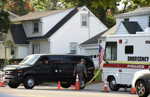 A New York State Police forensics unit returns to the scene of a quadruple homicide to continue their investigation at 1846 Western Avenue Friday morning, Oct. 10, 2014, in Guilderland, N.Y. (Skip Dickstein/Times Union) Photo: SKIP DICKSTEIN