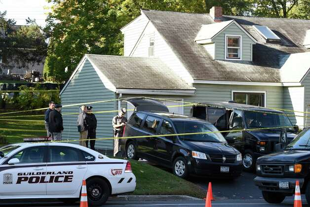 A New York State Police forensics unit returns to the scene of Wednesday's quadruple homicide to continue their investigation at 1846 Western Avenue Friday morning, Oct. 10, 2014, in Guilderland, N.Y.  (Skip Dickstein/Times Union) Photo: SKIP DICKSTEIN
